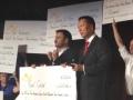 Matt Lloyd presenting John Chow with his big check!